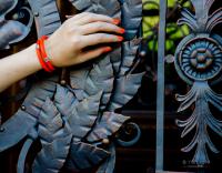 Браслет на оранжевом шнуре с символами