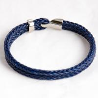 Серебряный браслет на тесно-синем кожаном шнуре